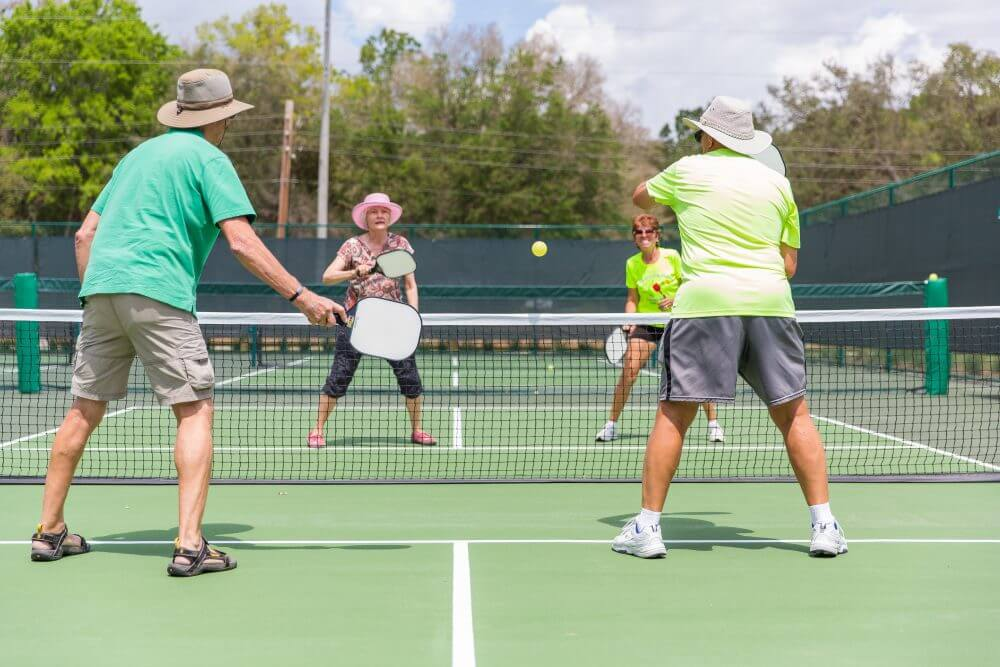 Pickleball game and pickleball players on court