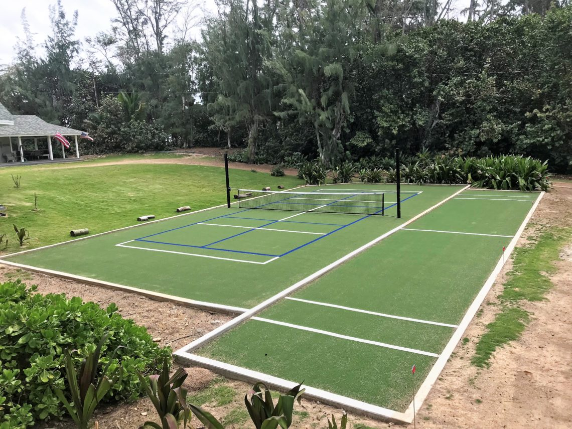 Pickleball game grass court