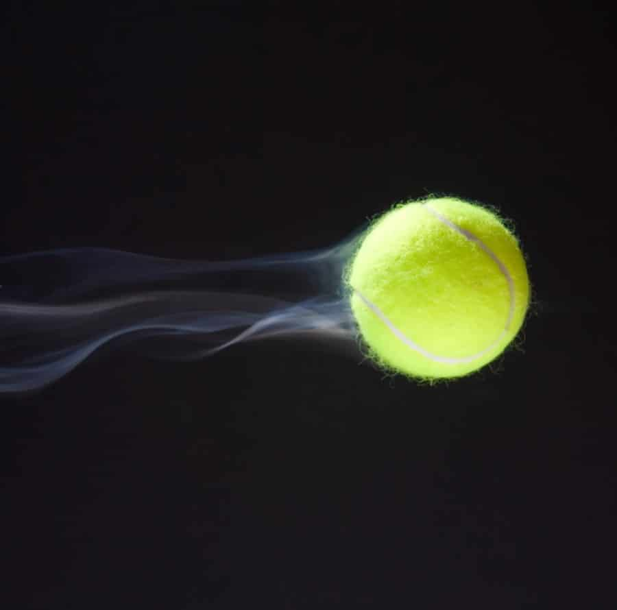 Tennis ball flying volley