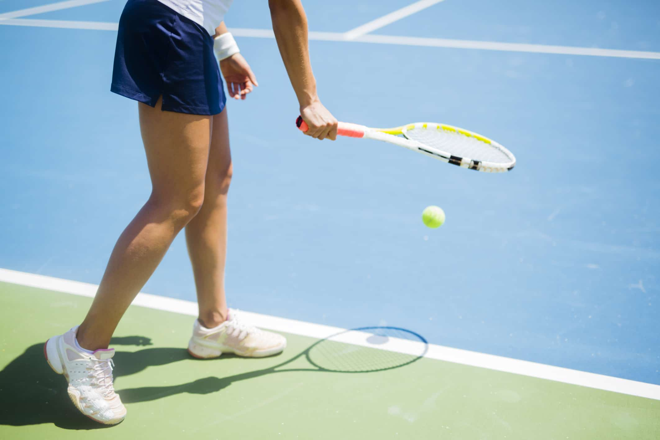 Why do tennis players bounce the ball before they serve